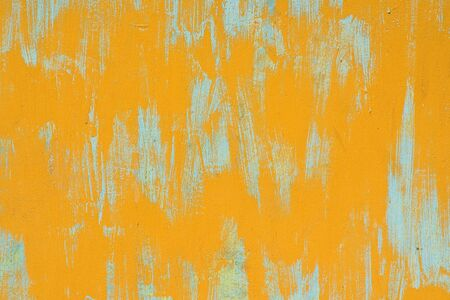 Yellow metal wall with blue stains, background photo