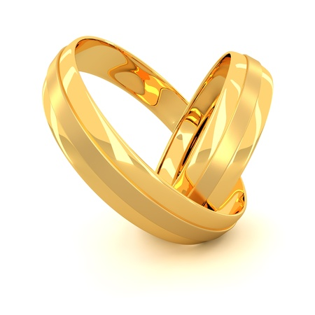 Two golden wedding rings isolated on white background photo