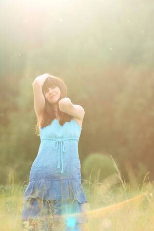Woman in blue dress on the meadow photo