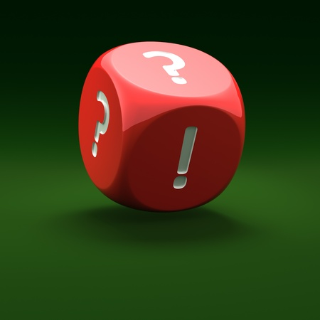 Red dice with question mark and exclamation mark on the green background  photo