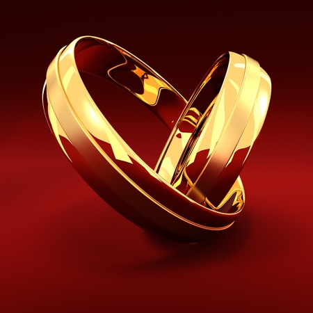 Two golden wedding rings on the red background