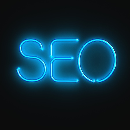 Luminous word SEO on the black background photo