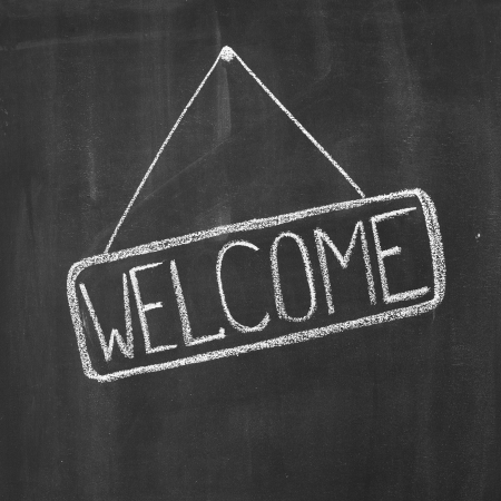 welcome sign: Word Welcome written by a chalk on a blackboard