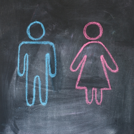 Figures of man and woman on a blackboard, chalk drawing Stock Photo - 12858259