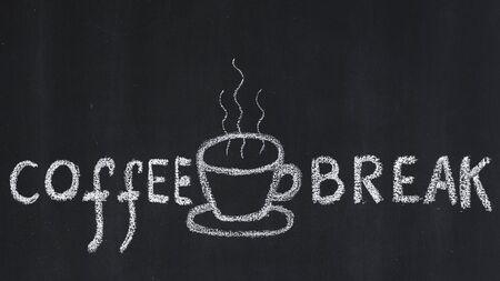Cup of hot coffee drawn on a blackboard photo