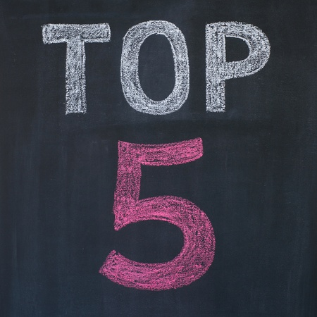 Word Top 5 written by a chalk on a blackboard photo