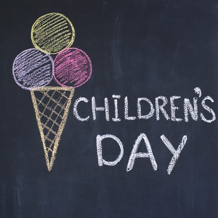 Childrens day written by a chalk on a blackboard photo