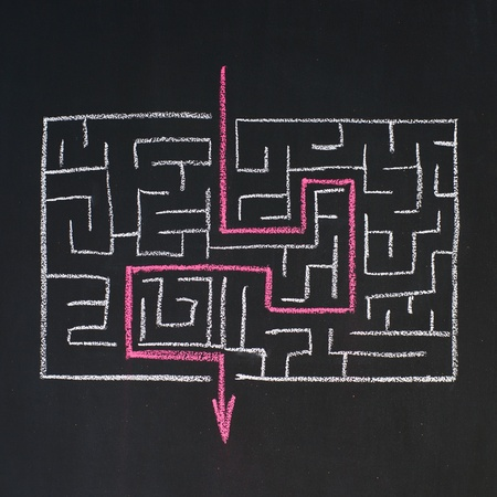 obstacle course: Way to the exit in labyrinth, drawn on a blackboard Stock Photo