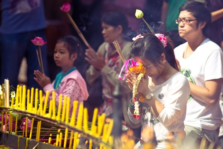 CHIANG MAI, THAILAND - JANUARY 7: Buddhist ceremony in the temple Wat Doi Suthep, Chiang Mai, Thailand on January 7, 2012