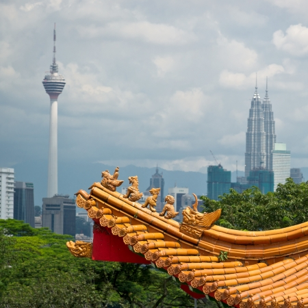 architectural styles: Mixture of architectural styles in Kuala Lumpur, Malaysia.  The roof of ancient chinese temple on the background of two symbols of Kuala Lumpur - KL Tower and Petronas Twin Towers. Editorial