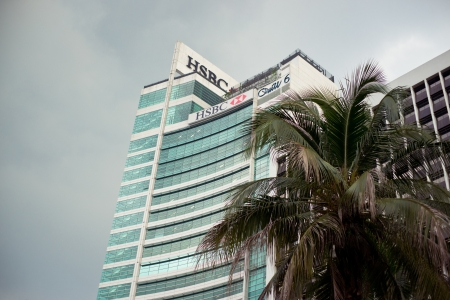 Kuala Lumpur, Malaysia - 14 December, 2012: HSBC  building in Kuala Lumpur financial district. HSBC Holdings plc (commonly known as HSBC) is a global banking and financial services company.
