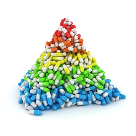 Medical pyramid made from multicolored layers of capsules photo