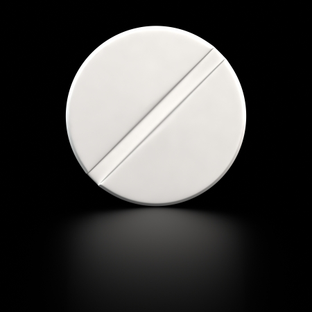 pill: Big white tablet of round shape on the black background