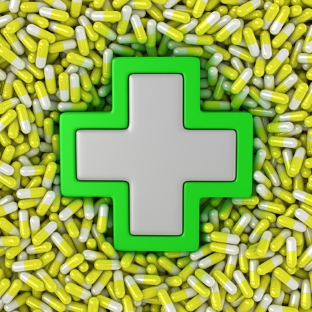 Medical cross sign on the yellow pills background Stock Photo - 14114859