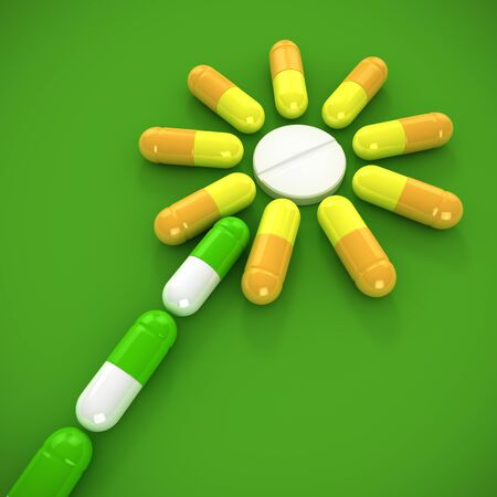 Flower made from medical capsules - concept of homeopathic medicine photo