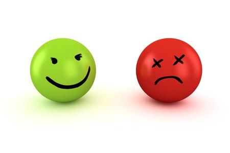 cara triste: Dos bolas con caras felices y tristes Foto de archivo