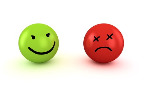 Two balls with happy and sad faces photo