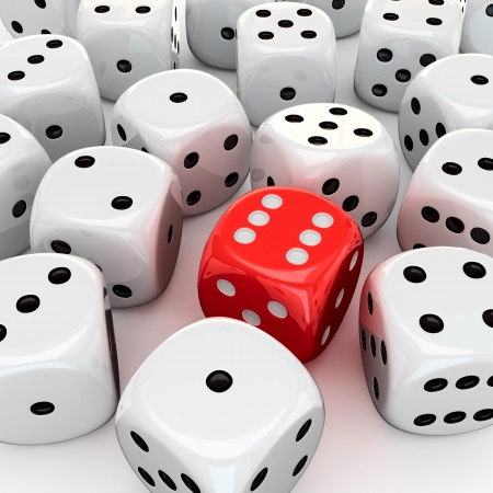 One red die with the number six in the heap of unlucky white dices photo