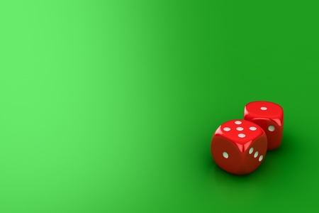 Red dice on the green background photo