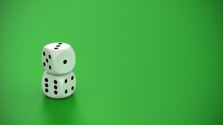 Two white dice on the green background photo