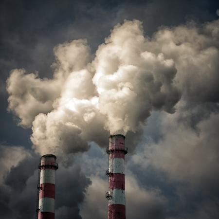 Two pipes smoke againts the cloudy sky Фото со стока - 19684967