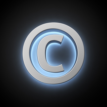 Copyright sign with backlight effect on the black background photo