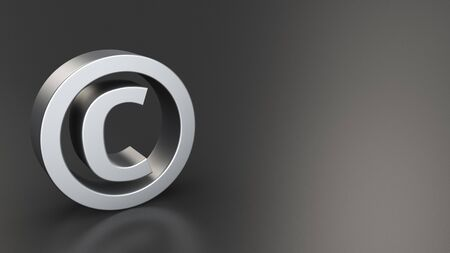 Metal copyright sign on black background with copyspace photo
