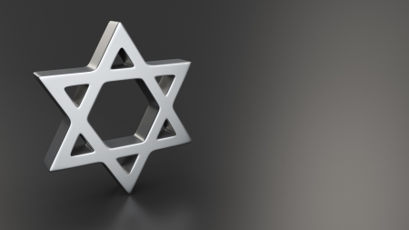 Metal star of David symbol on black background with copyspace photo