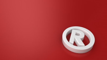 White registered mark symbol on red background with copyspace