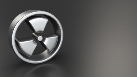 Metal radiation symbol on black background with copyspace photo