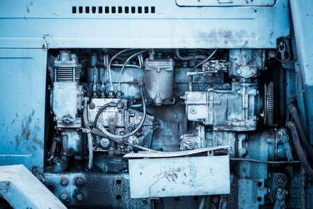 carburettor: Close-up of an old tractor engine
