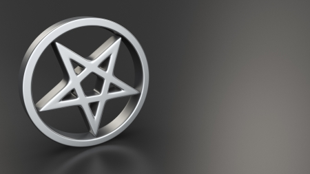 satanism: Metal pentagram symbol on black background with copyspace Stock Photo
