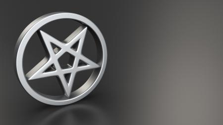 antichrist: Metal pentagram symbol on black background with copyspace Stock Photo
