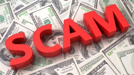 scam: Word Scam on the background of one hundred dollar bills