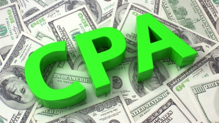 per: Word CPA on the background of one hundred dollar bills Stock Photo
