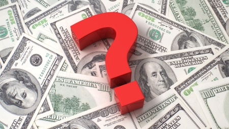 Red question mark on the background of one hundred dollar bills Standard-Bild