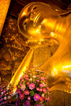Temple of the Reclining Buddha in Bangkok, Thailand photo