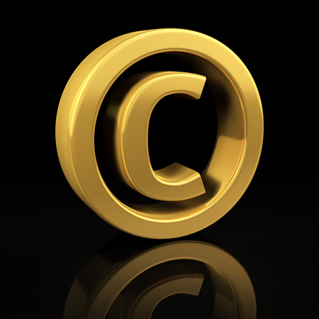 Copyright gold symbol on a black background with reflection