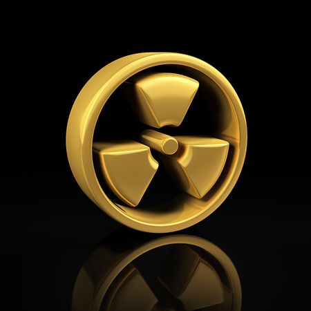 Radioactive danger gold symbol on a black background with reflection photo