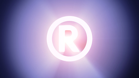 Radiant light from the symbol of registered sign photo