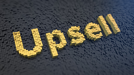 Word 'Upsell' of the yellow square pixels on a black matrix background. Vertical marketing concept. 写真素材