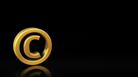 Gold copyright symbol on black background with reflection and copyspace. Good for slide with text photo