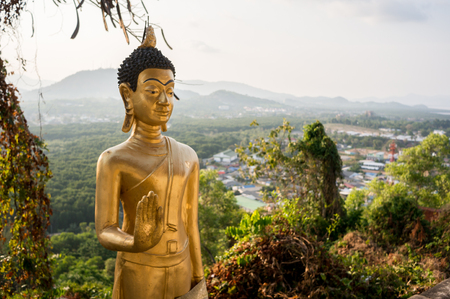 thai decor: Statue of Buddha on the background of Phuket island