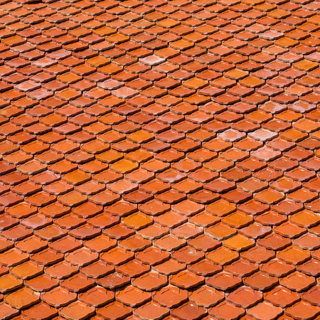 tiled: Terracotta tiled roof, textured material background