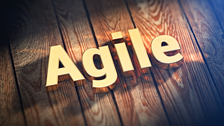 Contemporary design of business processes. The word Agile is lined with gold letters on wooden planks. 3D illustration image for blog article