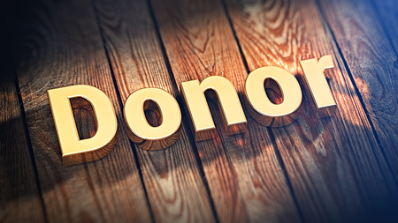 giver: The word Donor is lined with gold letters on wooden planks. 3D illustration graphics