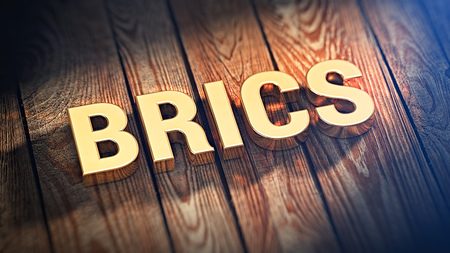 emerging markets: The acronym BRICS is lined with gold letters on wooden planks. 3D illustration picture Stock Photo