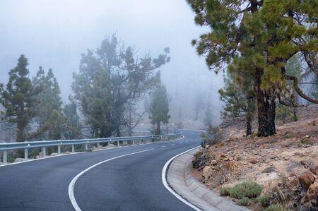 mountainous: Mountainous winding road in cloud to El Teide volcano, Tenerife, Canary Islands Stock Photo