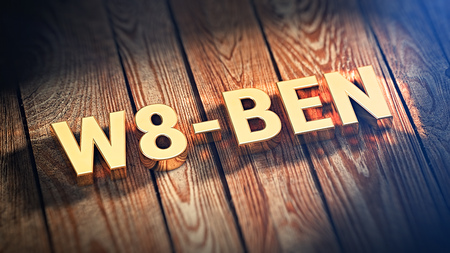 taxpayers: The acronym W8-BEN is lined with gold letters on wooden planks. 3D illustration Stock Photo
