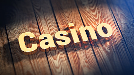 excitation: The word Casino is lined with gold letters on wooden planks. 3D illustration graphics